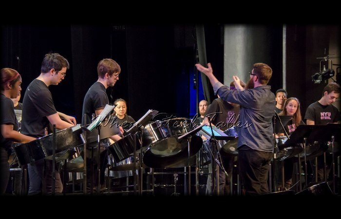 Josh Quillen, Director of NYU Steel, conducts the orchestra