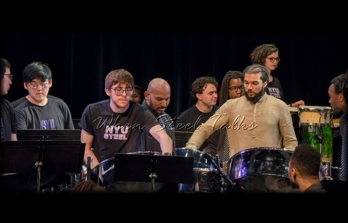 Andre White (tan shirt), with Pan Evolution Steel Orchestra & NYU Steel