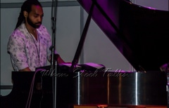 Khuent Rose on piano accompanying Kareem Thompson